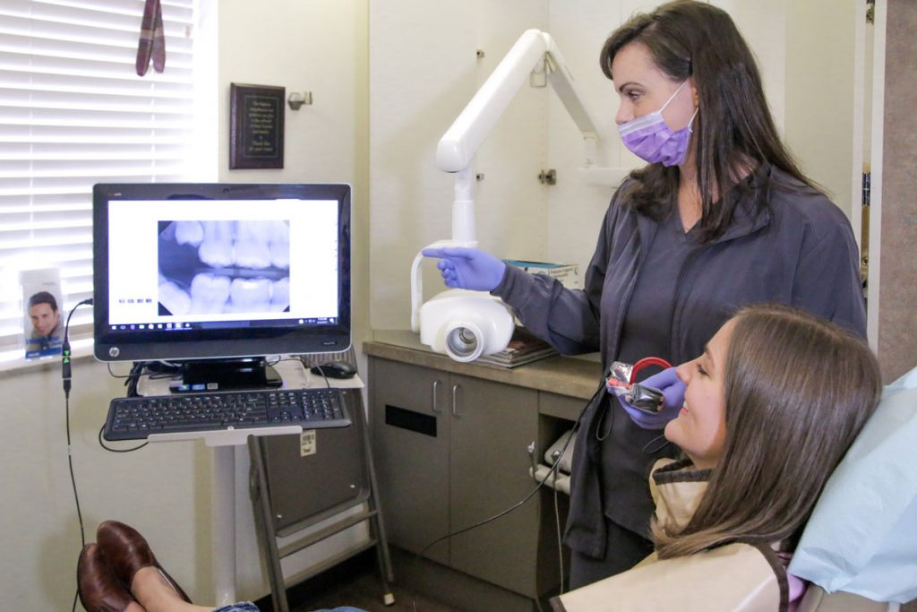 Dentist using dental imaging