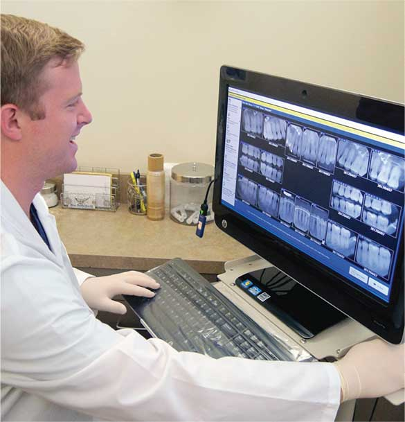 Dentist using DentiMax Dental Imaging Software
